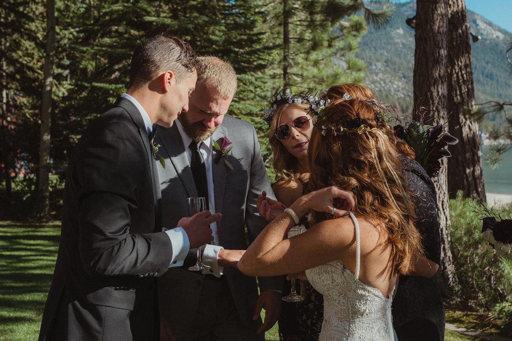 Incline village wedding groom looking at his wedding band photo