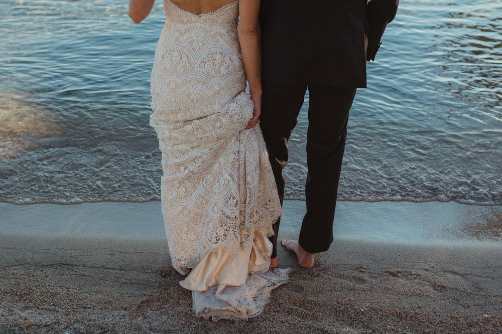 Incline village beach wedding couple standing by the beach photo