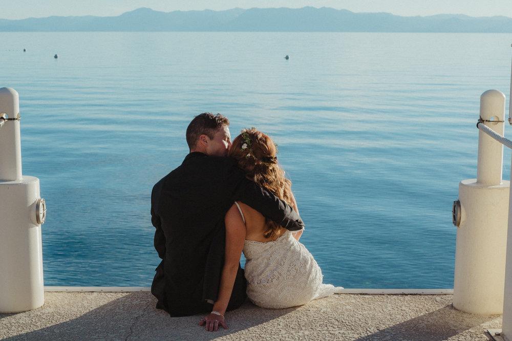 Incline village beach wedding couple sitting on the dock photo