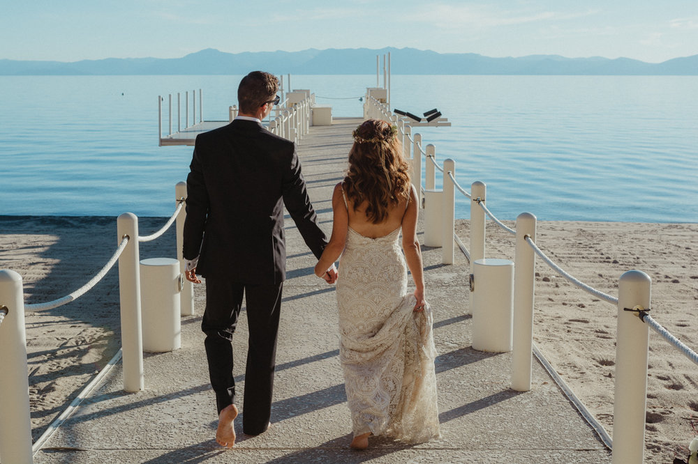 Incline village beach wedding couple walking on the dock photo