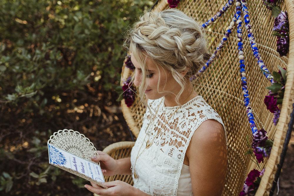 bohemian bride holding her invitation