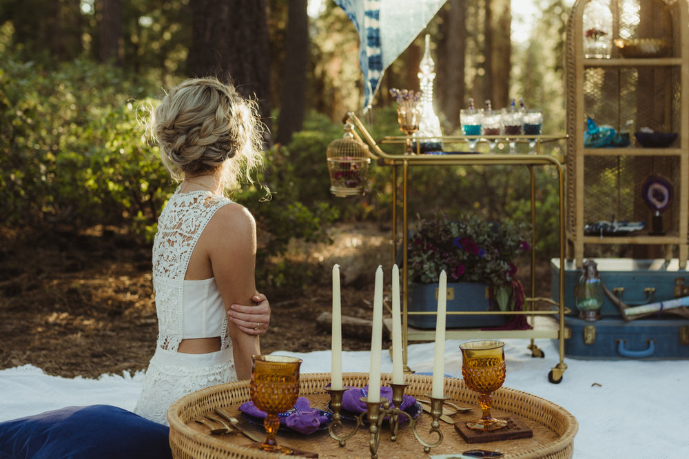 Bohemian styled shoot bride lounging photo
