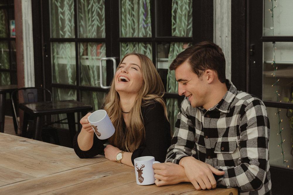 couple modeling mugs photo