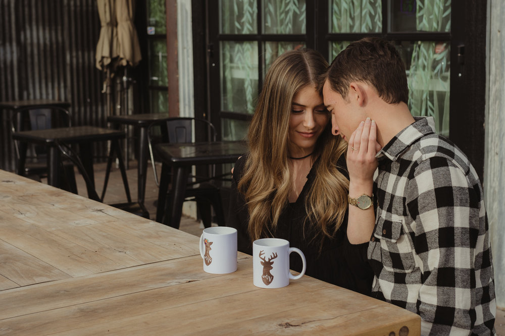 couple modeling mugs during their engagement session in Truckee CA