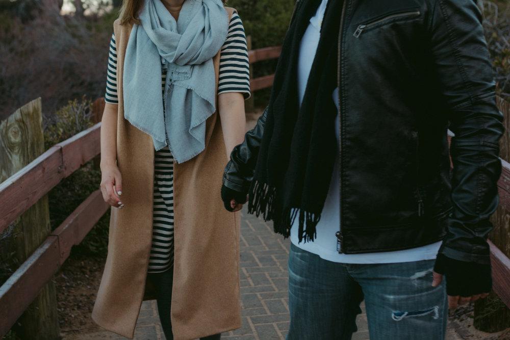 Lake Tahoe engagement session couple holding hands photo