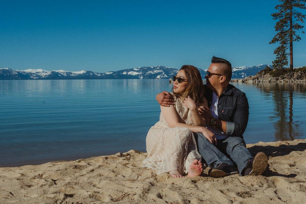 Lake Tahoe engagement session couple looking towards the lake photo