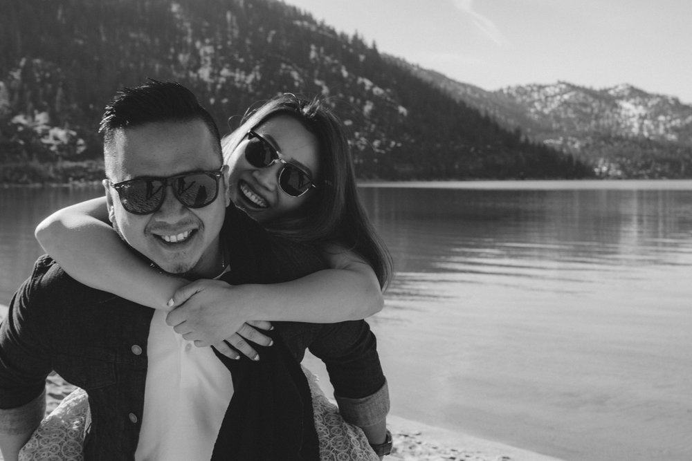 Lake Tahoe session couple playing on the beach photo