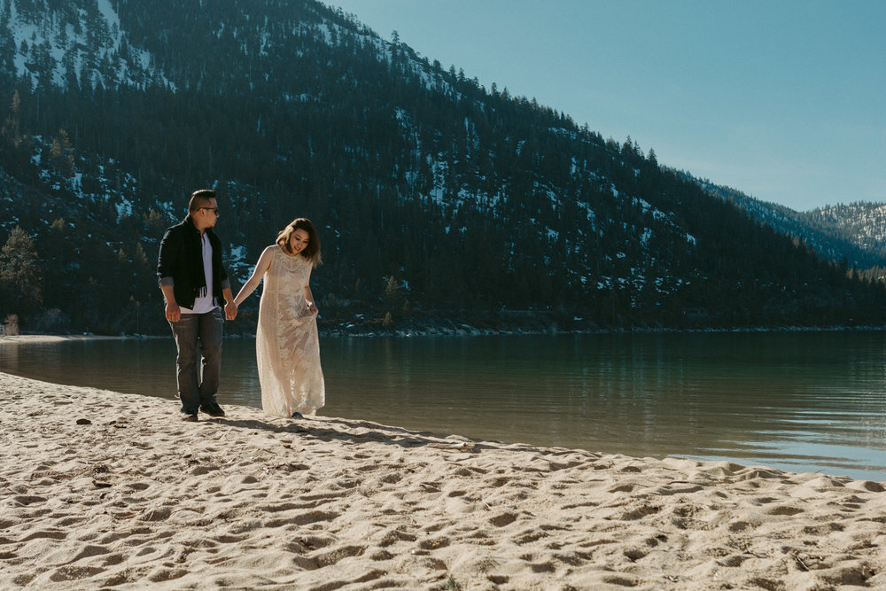 Lake Tahoe session couple walking on the beach holding hands photo
