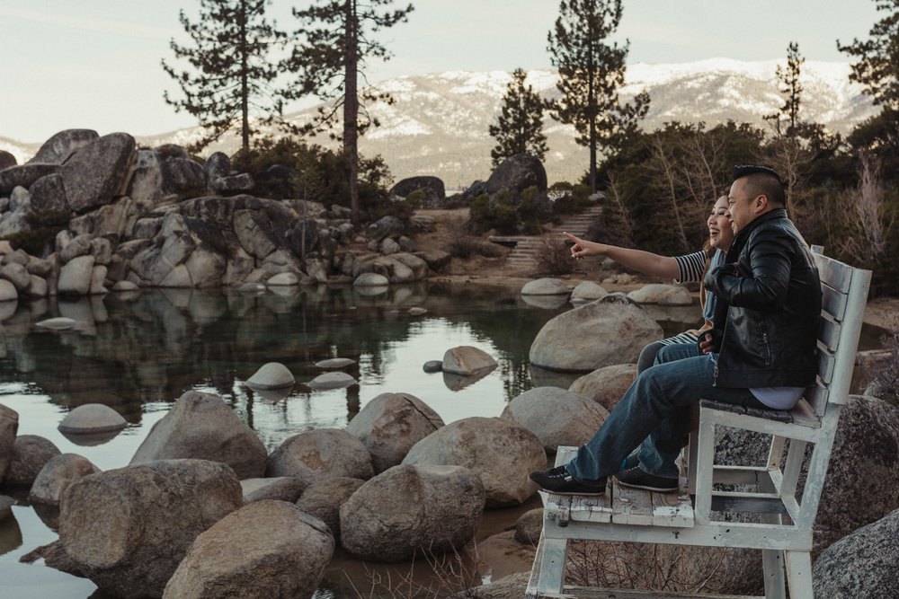 Lake Tahoe engagement session girl pointing to the horizon photo
