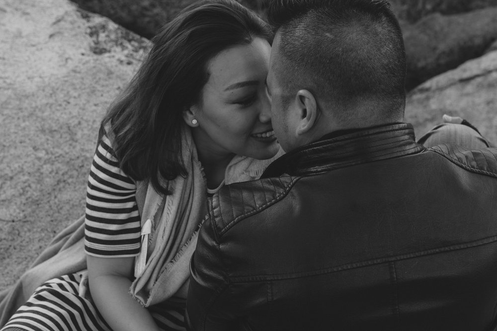 Lake Tahoe engagement session couple giving each other an eskimo kiss photo