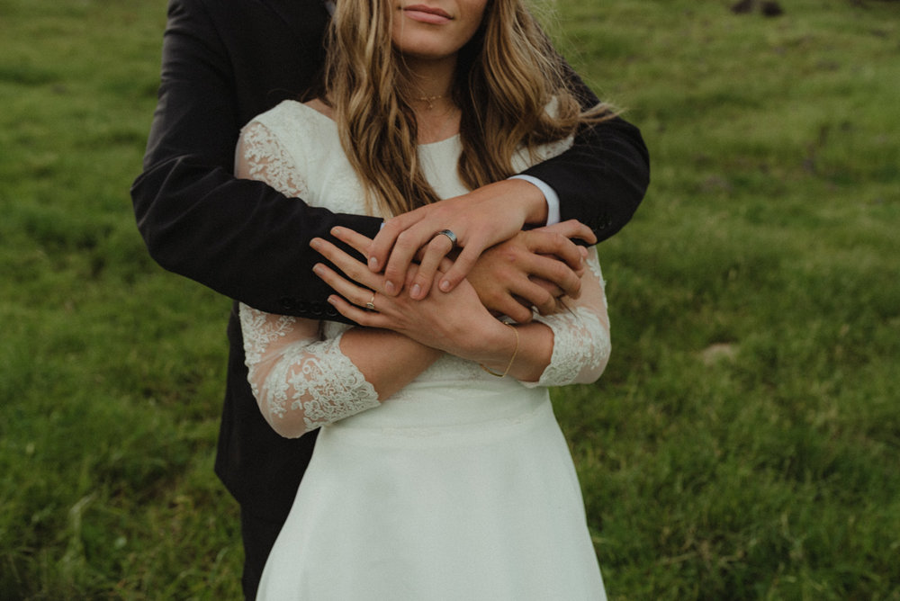Vacaville wedding couple holding each other tight on a hill photo