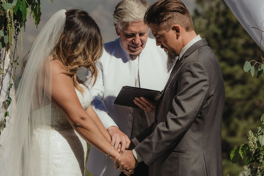 Tannenbaum wedding ceremony couple praying together photo