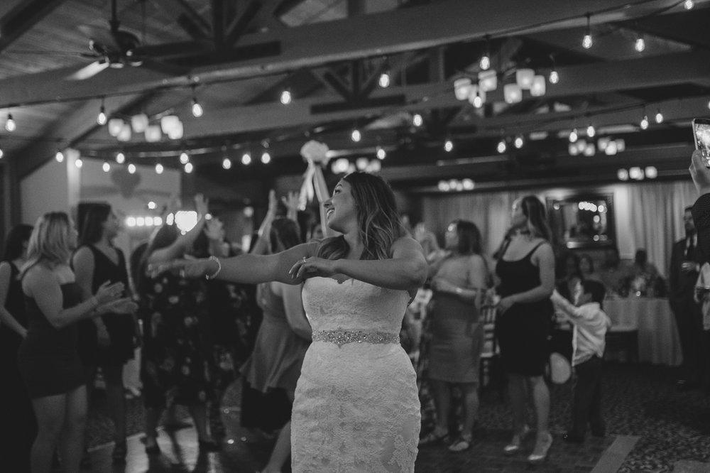 Tannenbaum wedding bouquet toss photo