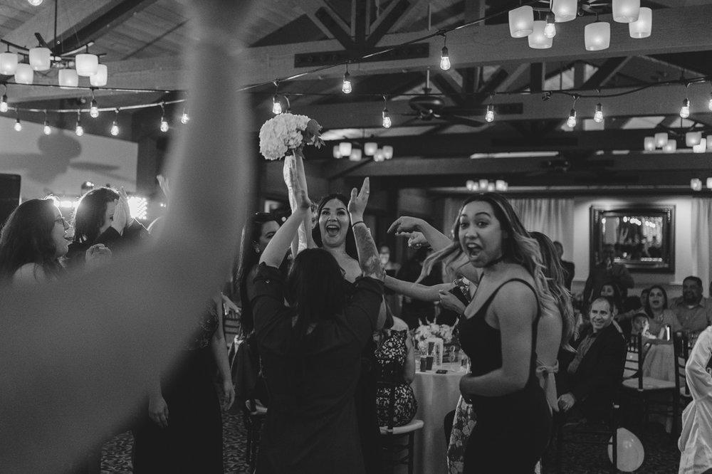 Tannenbaum wedding bouquet being tossed photo