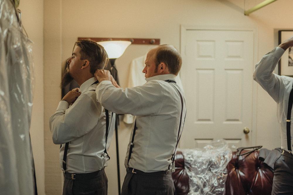 Tannenbaum Wedding Venue, groom putting on his tie photo