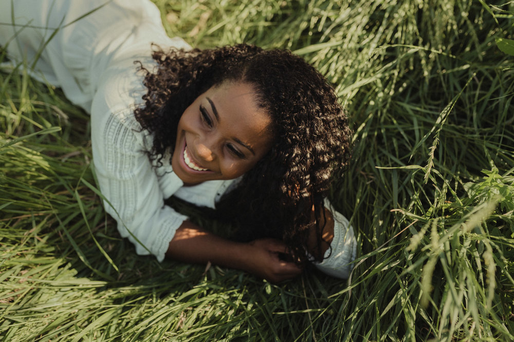 Reno senior photography, girl laughing on the grass photo.