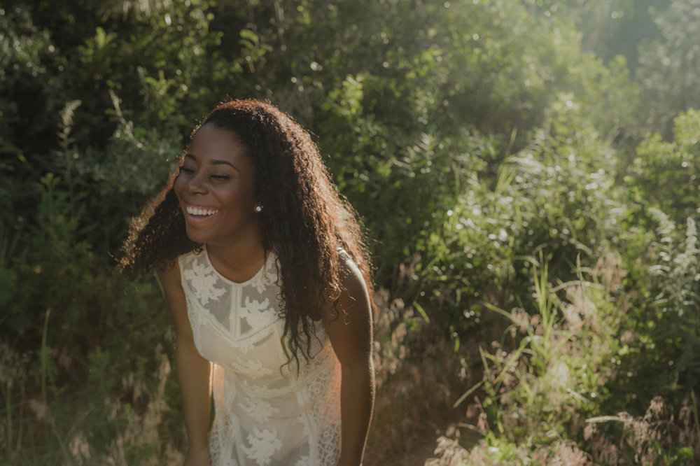 Reno bohemian senior photography, girl laughing photo.
