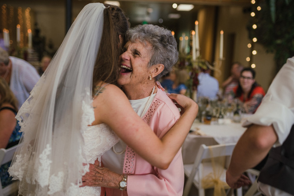 Wilbur D May Museum wedding, bride hugging her grandma photo