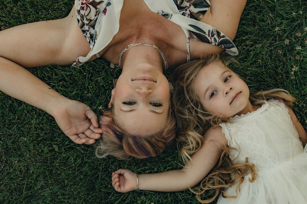 Rancho San Rafael Regional Park photo session, mom and daughter laying on the ground together photo