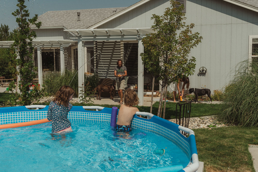 Reno home session kids playing in the pool photo