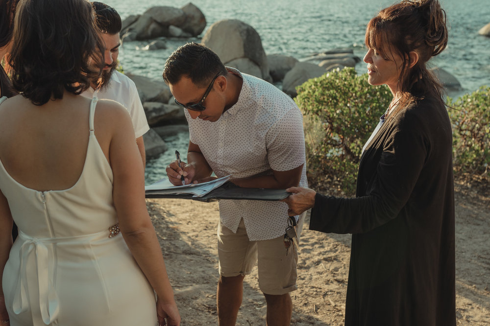 Lake Tahoe elopement signing legal papers photo