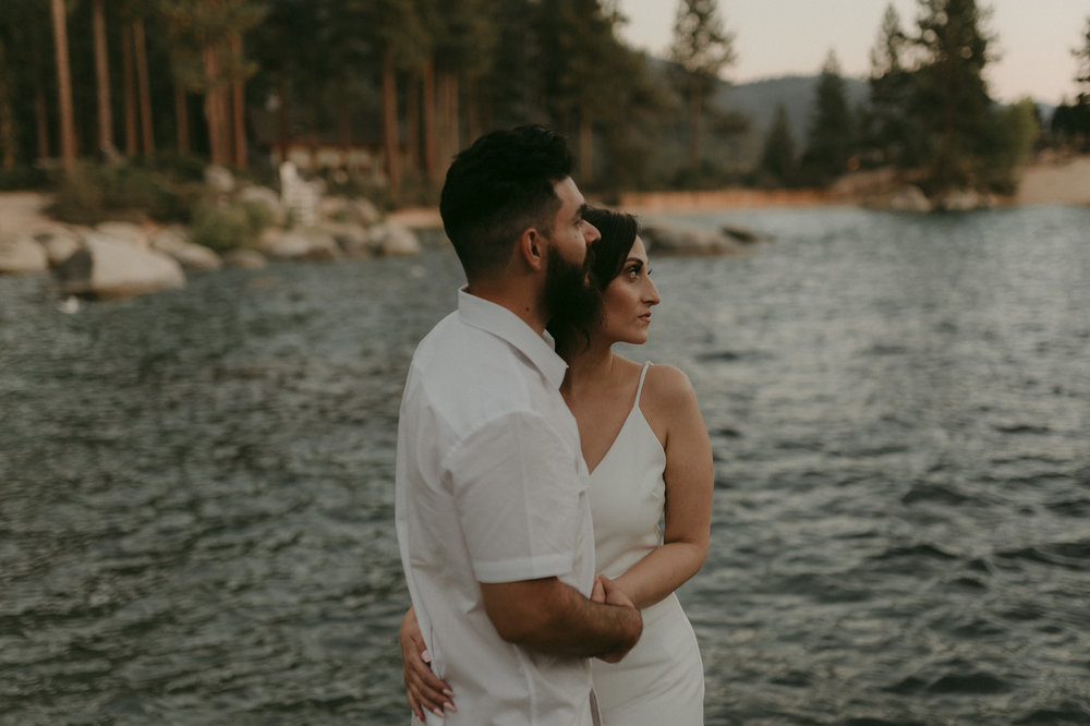 Lake Tahoe elopement couple looking out towards the horizon photo