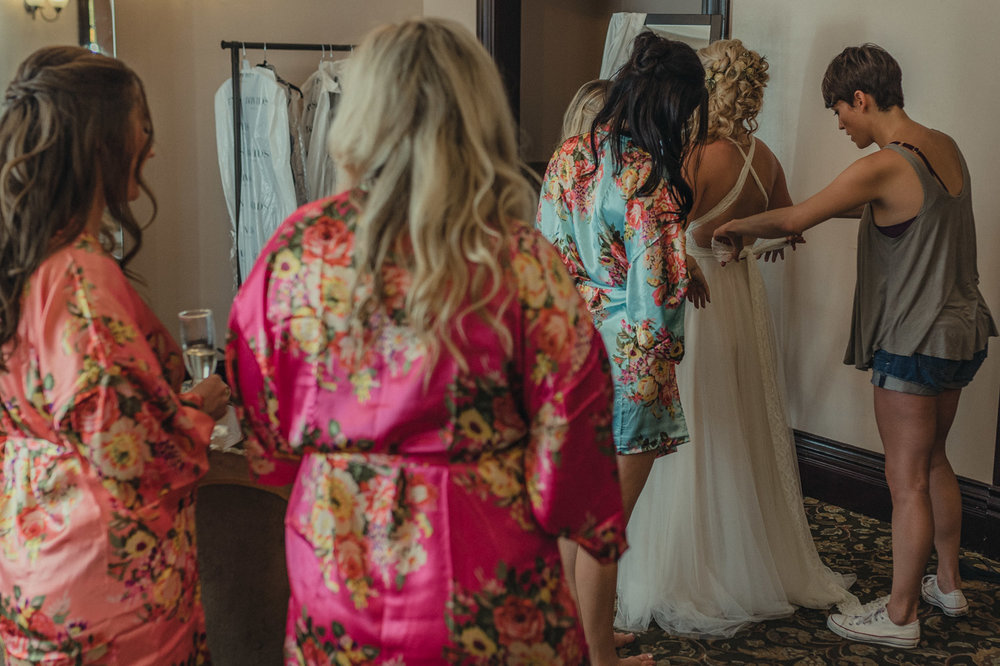 Wedgewood Sequoia Mansion wedding bridesmaids looking at bride get ready photo