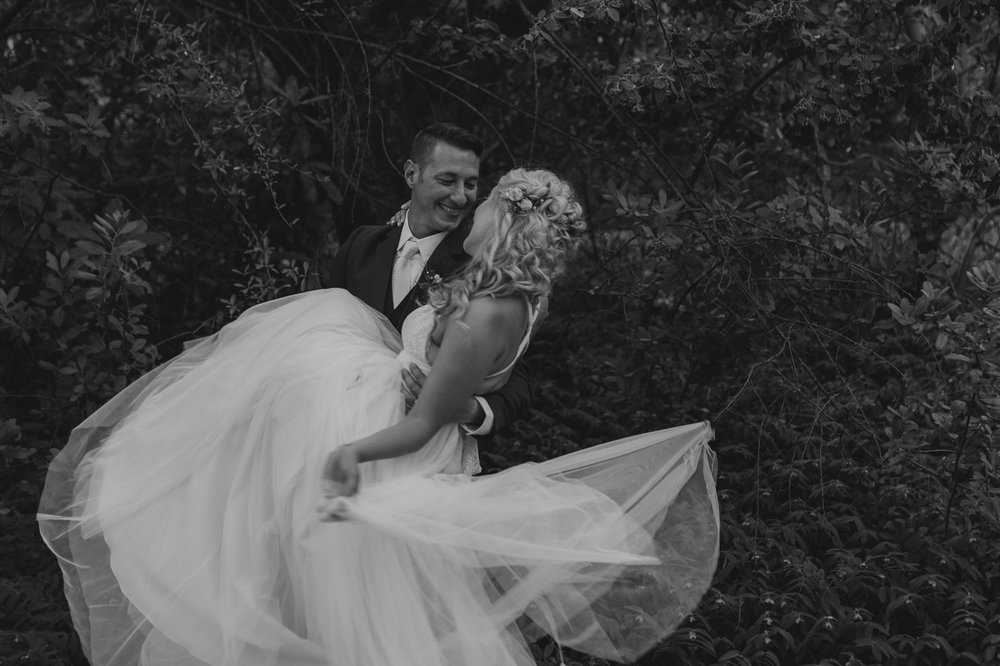 Wedgewood Sequoia Mansion wedding groom picking up her bride photo