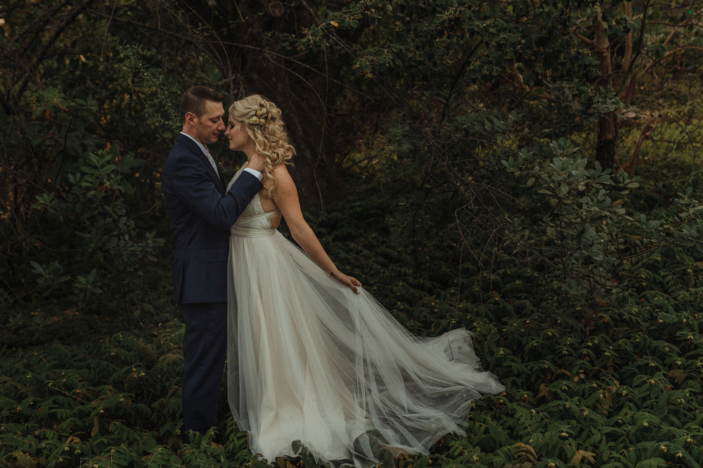 Wedgewood Sequoia Mansion wedding bride holding her dress photo