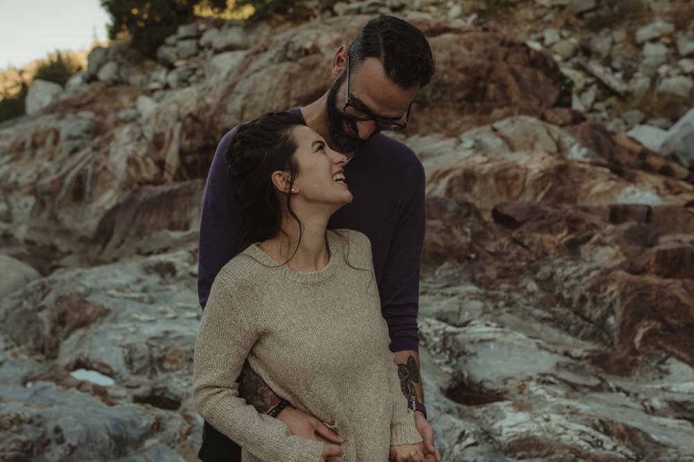 Yuba River engagement couple laughing together photo