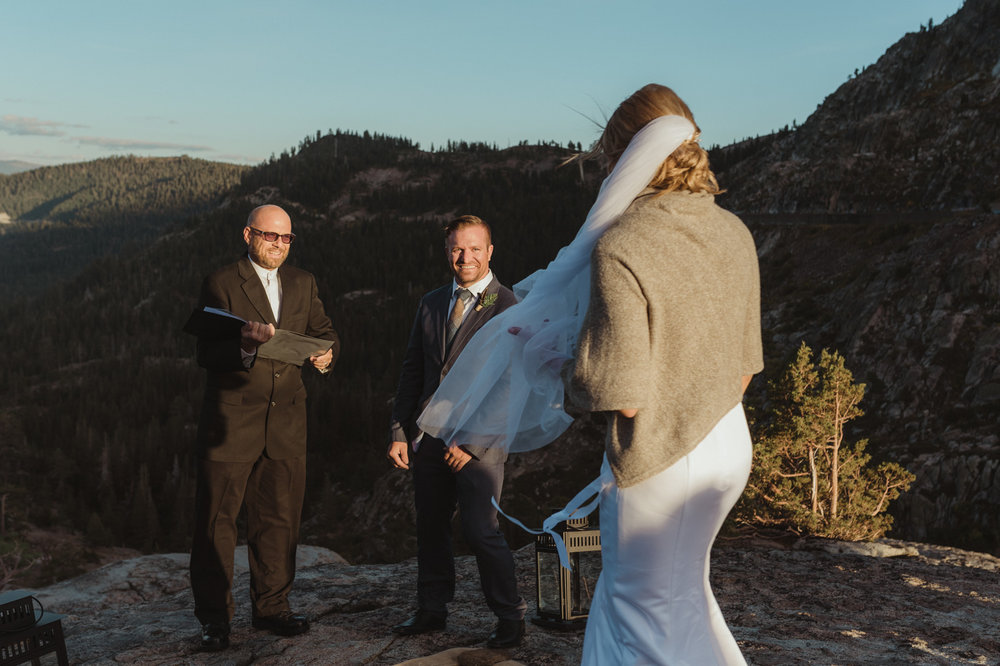 North Lake Tahoe wedding bride walking down the isle with the sun glowing behind her photo