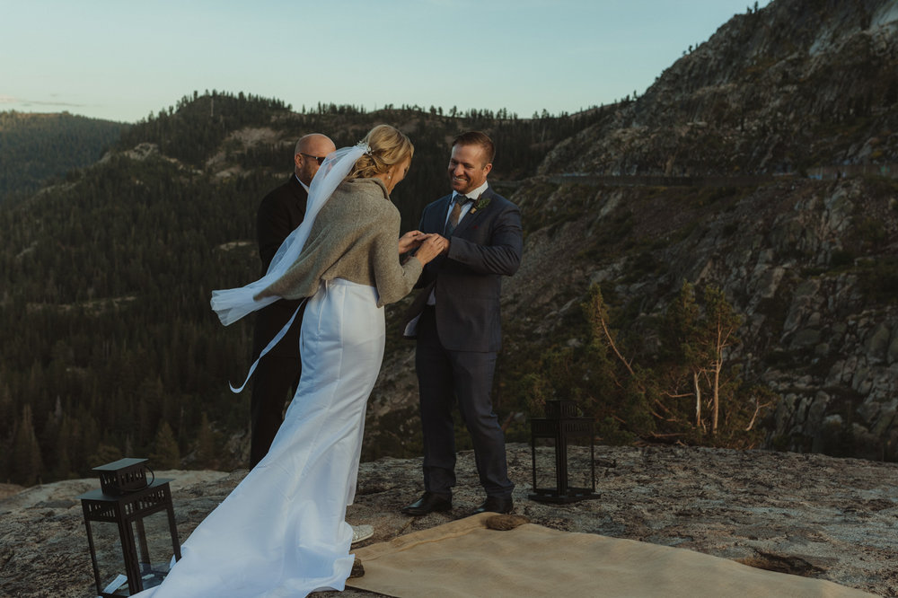 North Lake Tahoe wedding bride putting ring on grooms finger photo