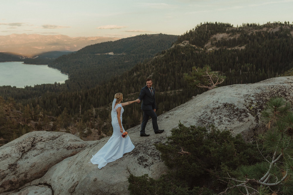 North Lake Tahoe wedding couple walking up a rock photo
