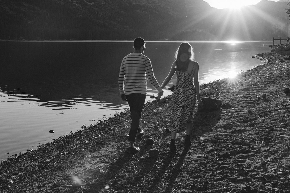 North Lake Tahoe engagement couple running towards the sun photo