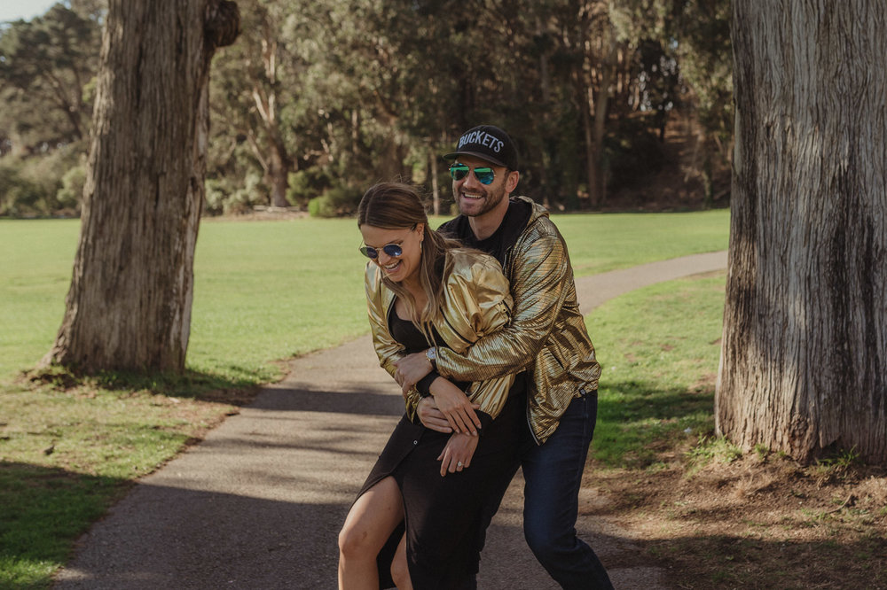 San Francisco engagement photos at Golden Gate Park couple laughing photo