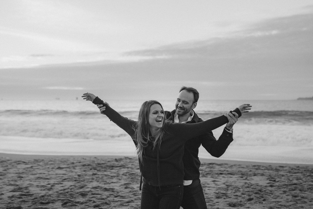 San Francisco engagement couple being silly at Baker Beach photo