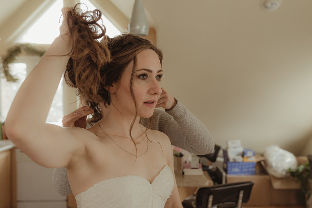 At home Reno wedding bride getting dressed up photo