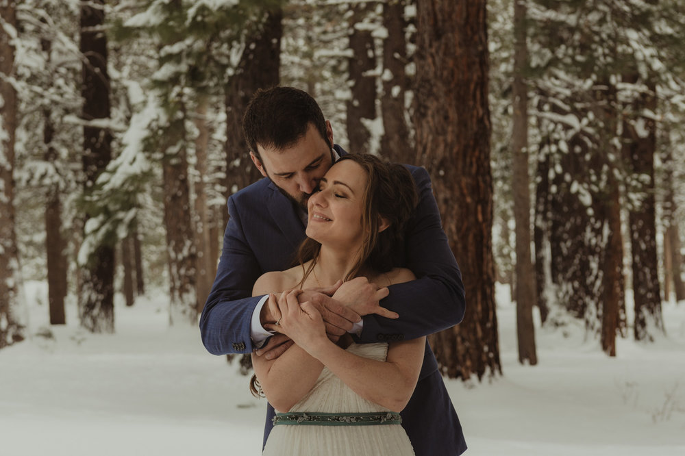 Lake Tahoe winter wedding couple hugging each other photo