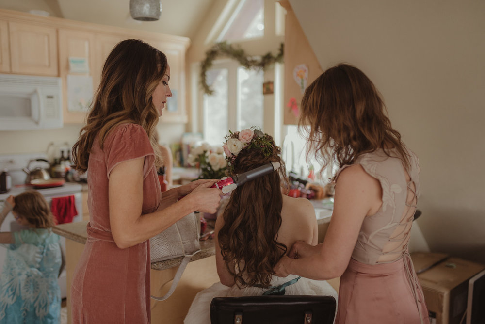 Reno home wedding bride getting her hair done photo