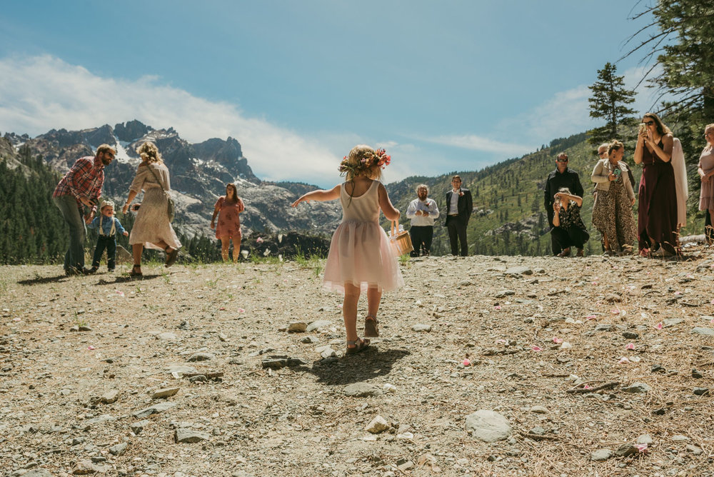 Elopement in Sardine Lake, ceremony photo, flower girl throwing petals