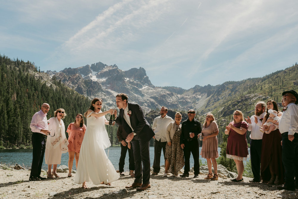 Sardine Lake Resort, Sierra Buttes elopement, couple popping champagne photo