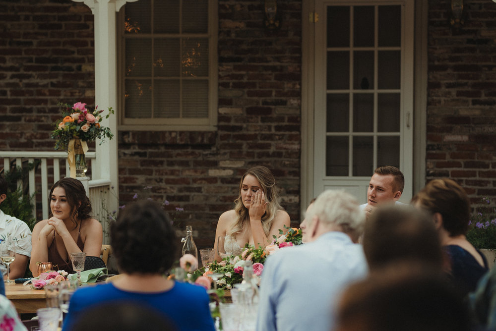 Twenty Mile House wedding, bride tearing up during toasts photo