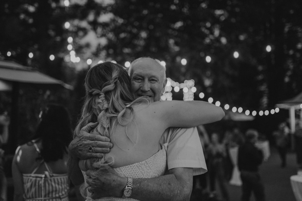 Twenty Mile House wedding bride hugging a guest photo
