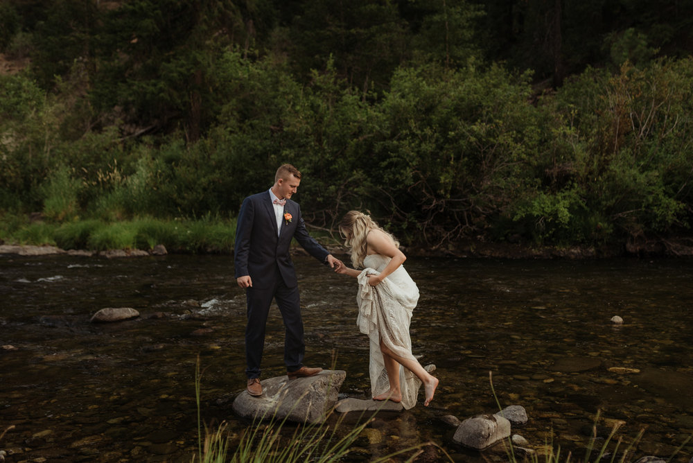 Twenty Mile House wedding couple walking on the river photo