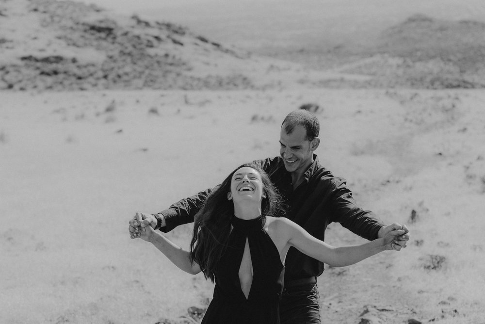 Nevada desert engament session inspiration couple being playful photo