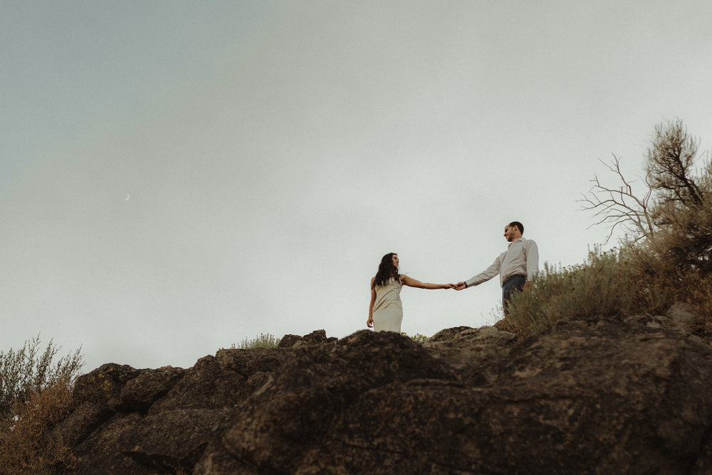 Lake Tahoe engagment session inspiration couple holding hands on a ridge photo