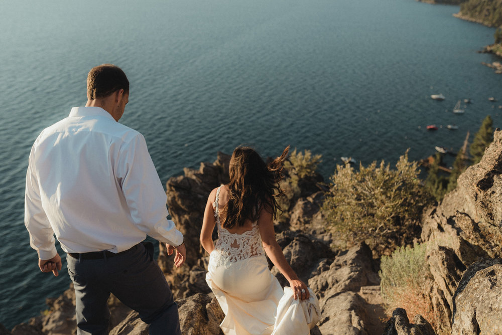 Cave Rock engagement photo inspiration, couple walking down to a viewpoint photo