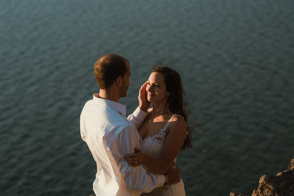 Cave Rock engagement photo inspiration, couple enjoying sunset photo
