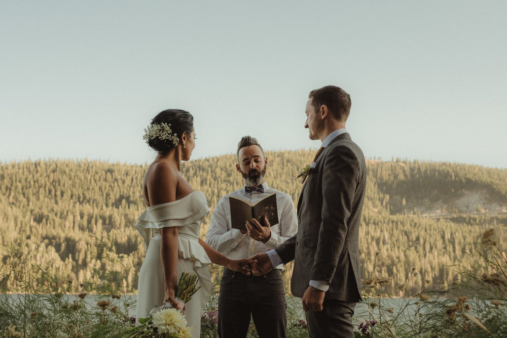 Lake Tahoe pop-up wedding/elopement couple exchanging vows photo
