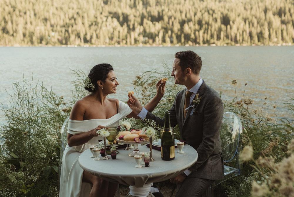 Lake Tahoe pop-up wedding/elopement couple enjoying dessert at their sweetheart table